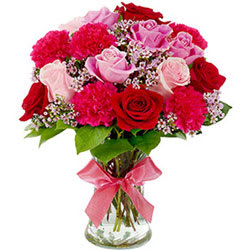 Sweet Graceful Bunch of Mixed Flowers in a Glass Vase